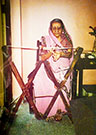 Mrs. Najamai M. Kotwal weaving a kustīg, Mumbai, 1990. (Photograph courtesy of F. M. Kotwal)
